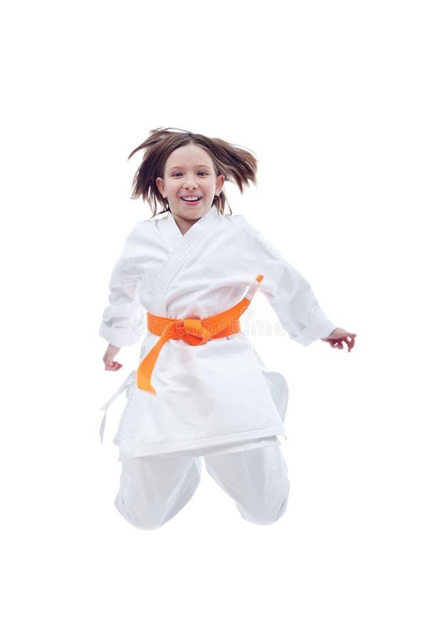 Menina de salto do karaté no quimono fotos de stock royalty free