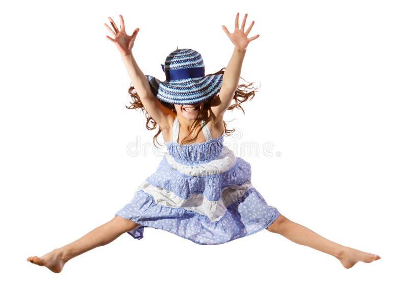 Menina de salto com chapéu fotografia de stock royalty free