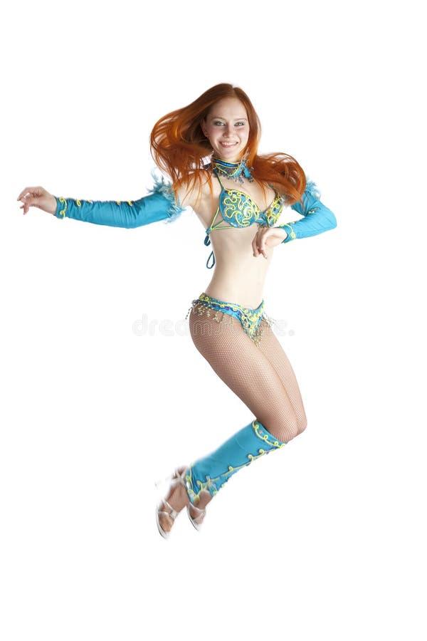 Menina de salto no terno do carnaval foto de stock