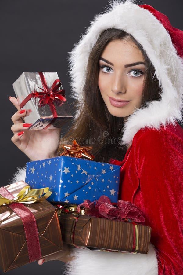 Menina de Santa com caixas atuais fotos de stock royalty free