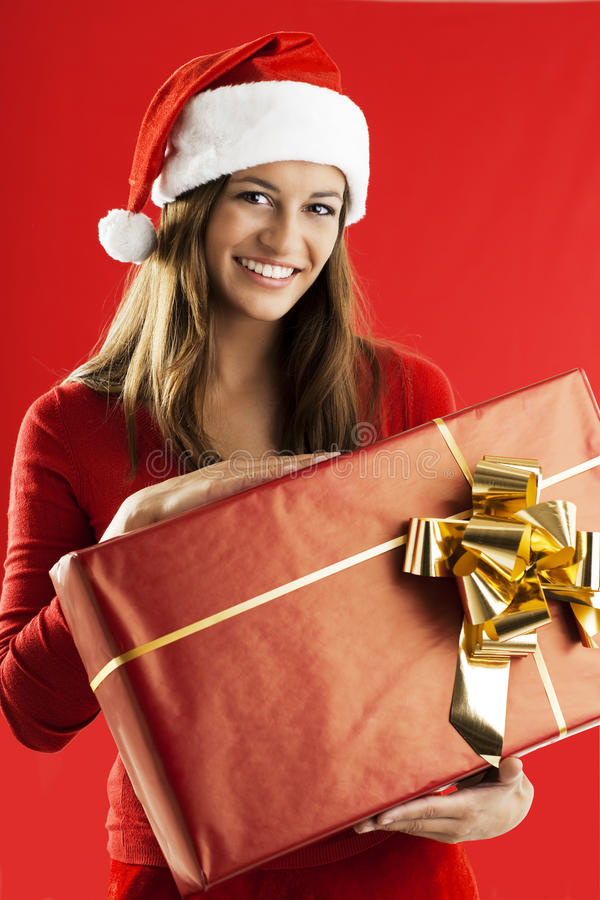 Menina de Santa com um presente grande fotos de stock royalty free