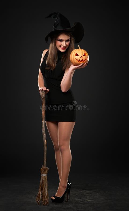 A menina de sorriso é a bruxa fotografia de stock royalty free