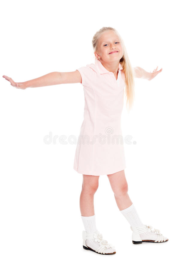 A menina de sorriso abriu seus braços aos lados imagens de stock royalty free