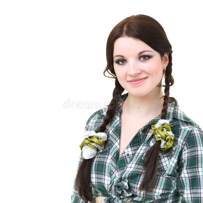 Menina de sorriso amigável com pigtails fotografia de stock