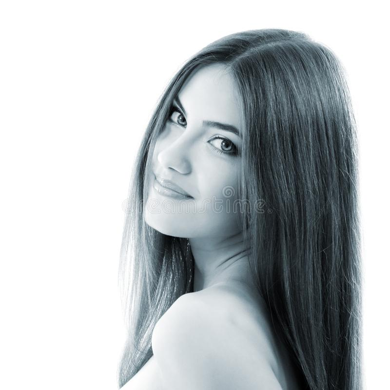 Menina de sorriso bonita, close up fêmea da cara, luz tonificada - azul, i fotografia de stock