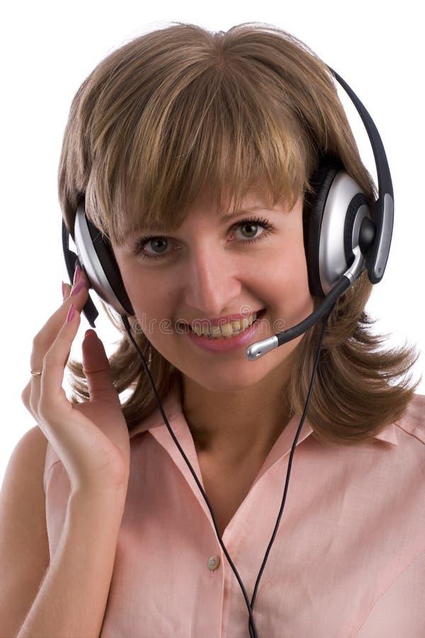 Menina de sorriso com auriculares fotografia de stock royalty free