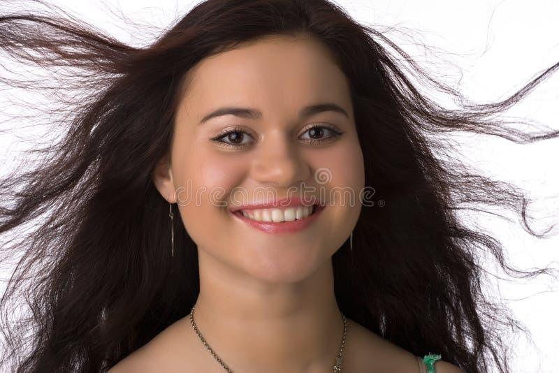 Menina de sorriso com cabelo desarrumado fotografia de stock royalty free