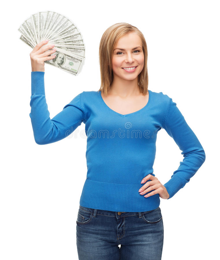 Menina de sorriso com dinheiro do dinheiro do dólar fotografia de stock royalty free