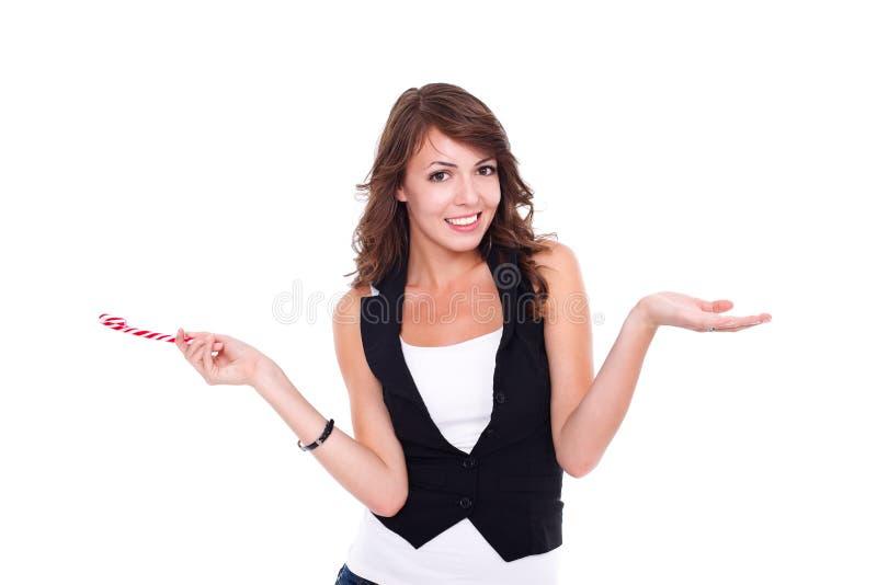Menina de sorriso com pirulito imagem de stock royalty free