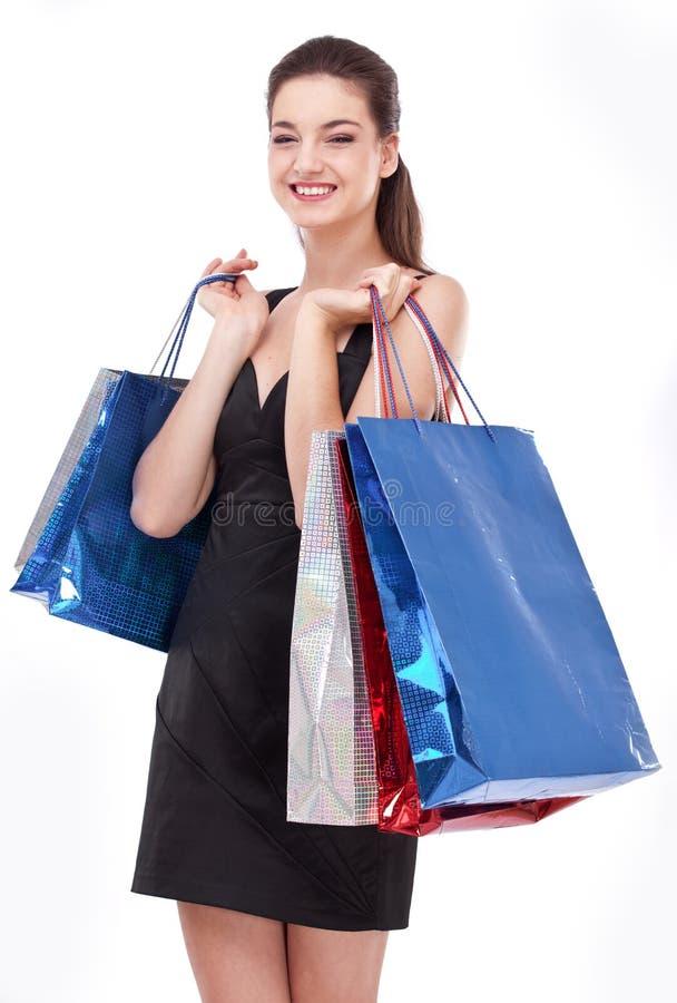 Menina de sorriso com sacos de compra. fotos de stock royalty free