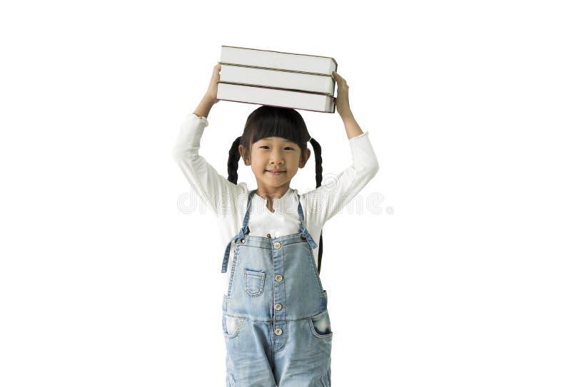 Menina de sorriso feliz do estudante com os livros isolados no fundo branco fotos de stock