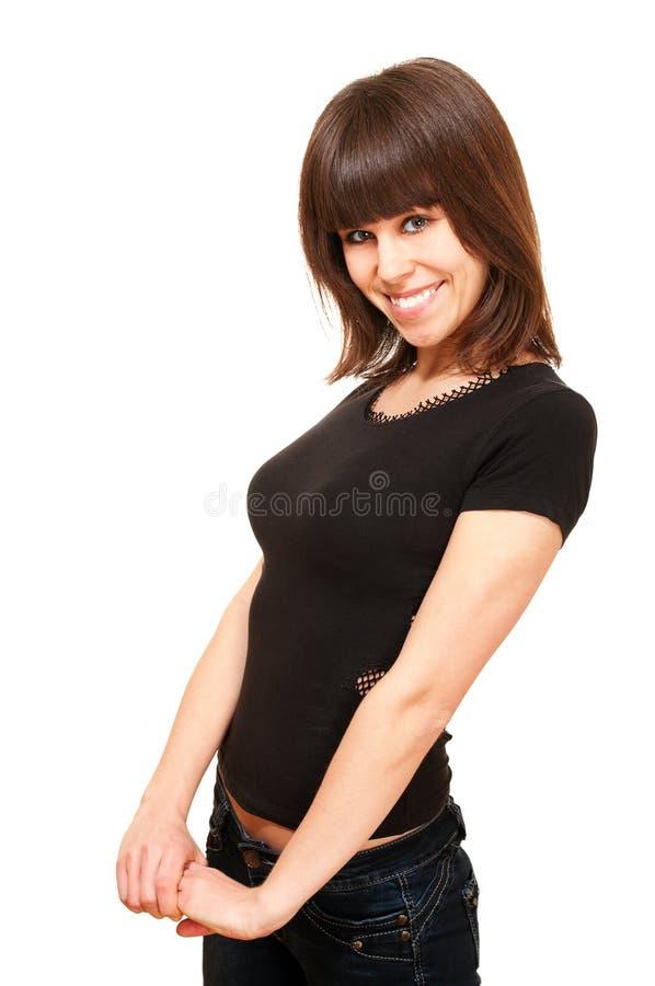 Menina de sorriso impertinente na camisa preta imagens de stock