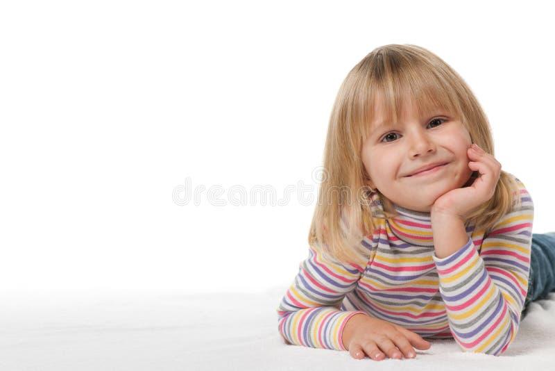 Menina de sorriso no branco imagens de stock royalty free