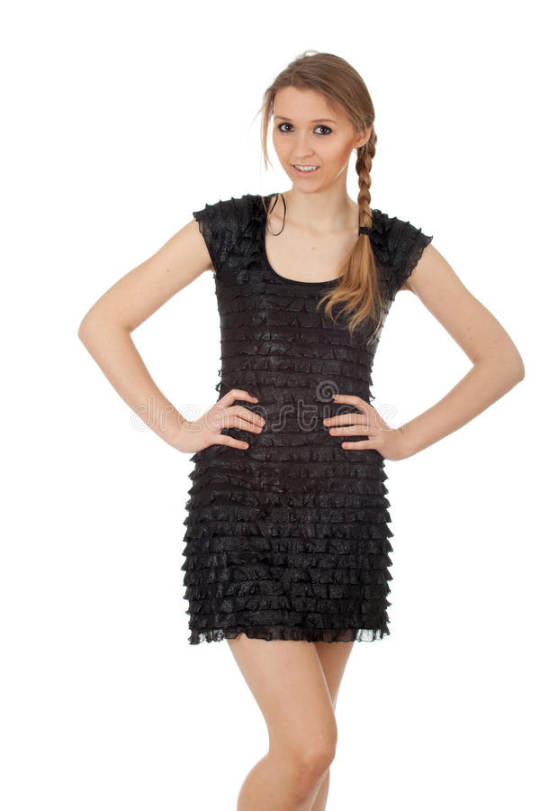 Menina de sorriso no vestido preto fotografia de stock