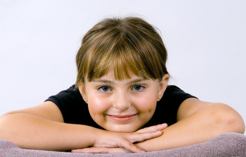 Menina de sorriso nova imagem de stock