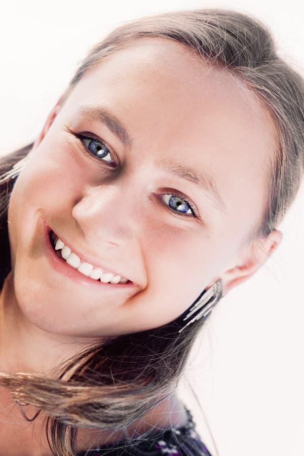 Menina de sorriso nova no fundo branco fotografia de stock royalty free