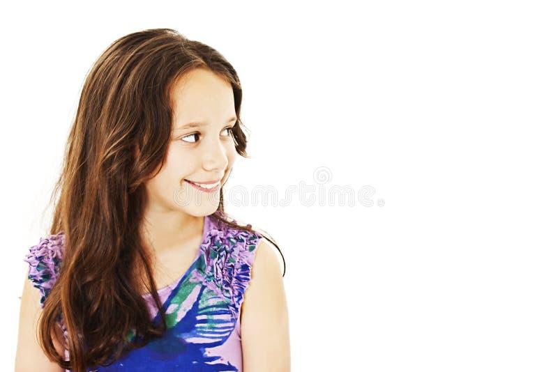 Menina de sorriso que olha a área de espaço da cópia imagens de stock
