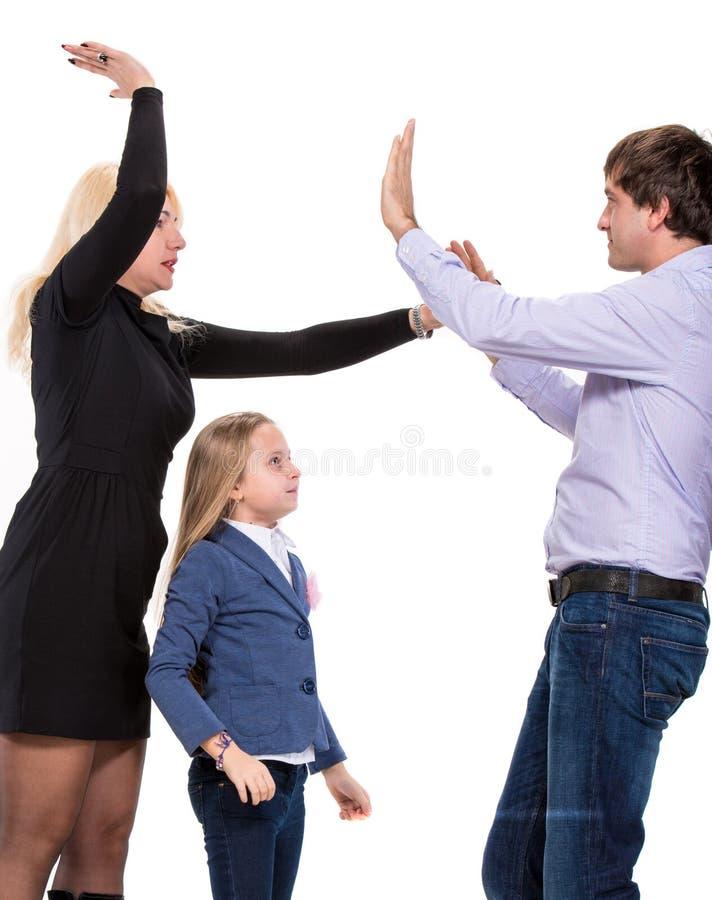 Menina de vista triste com seus pais de combate fotos de stock royalty free