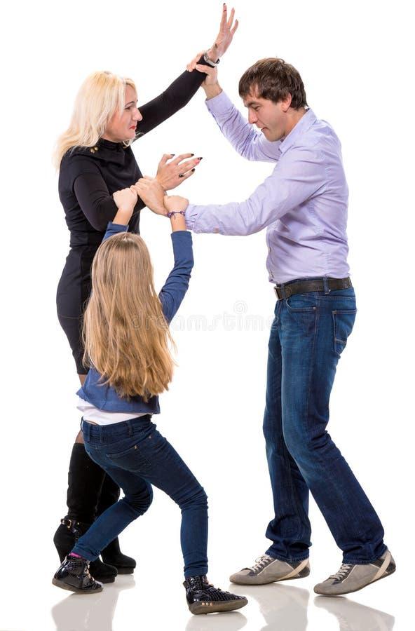 Menina de vista triste com seus pais de combate imagens de stock royalty free