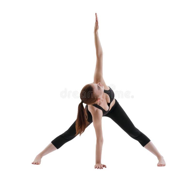 Menina de Yuong que faz o tiro isolado ioga imagens de stock royalty free