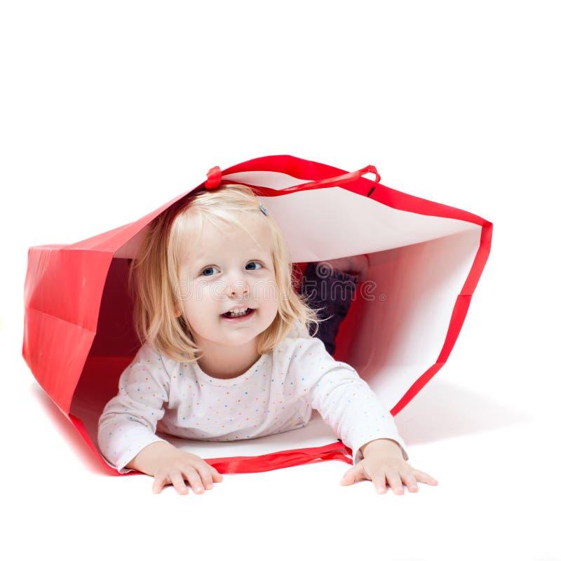 A menina dentro do pacote fotografia de stock