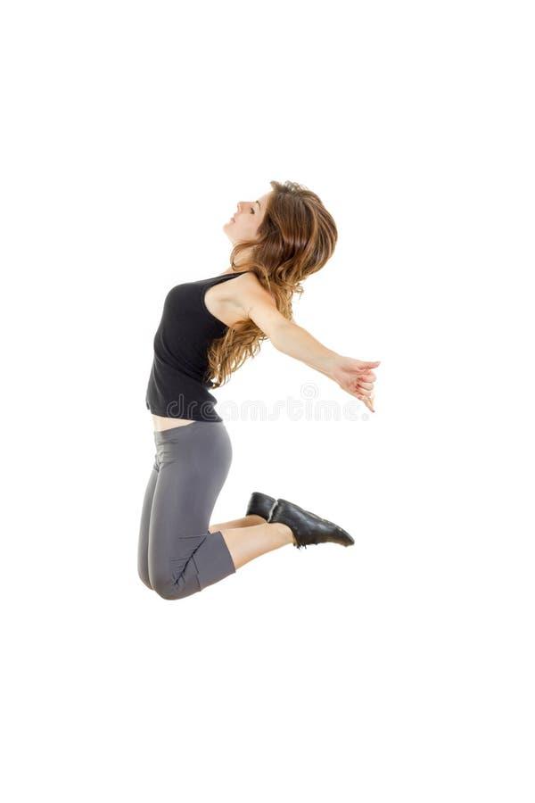 Menina desportiva que faz esticando exercícios teena magro do estilo do hip-hop imagens de stock royalty free