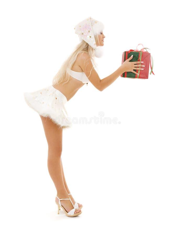 Menina do ajudante de Santa com caixa de presente imagem de stock