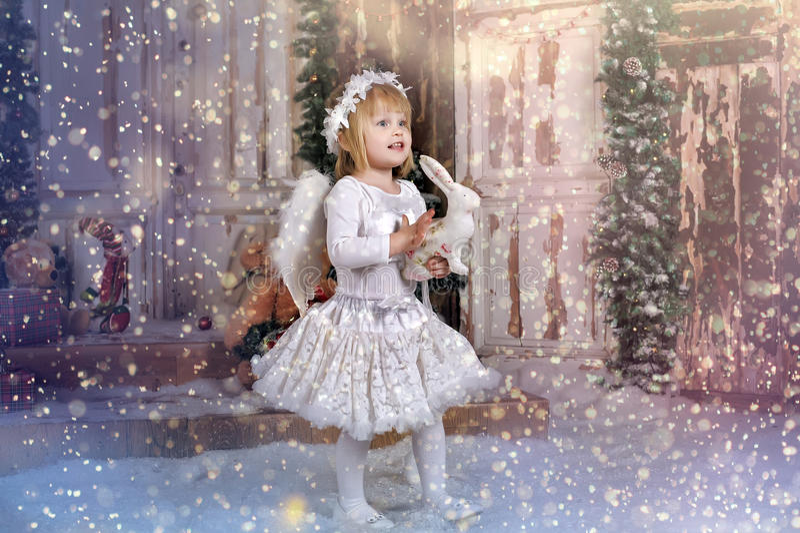 Menina do anjo do Natal imagem de stock