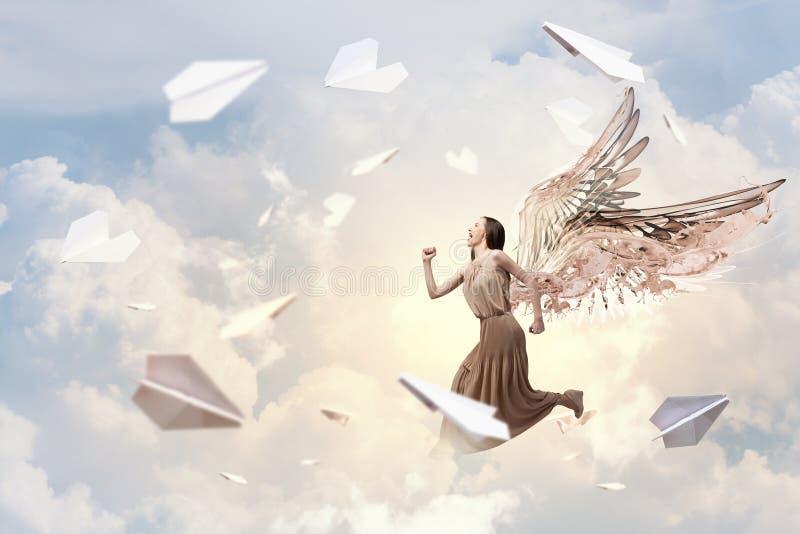 Menina do anjo no vestido fotografia de stock royalty free