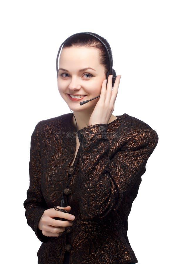 Menina do centro de atendimento que sorri no branco imagens de stock royalty free