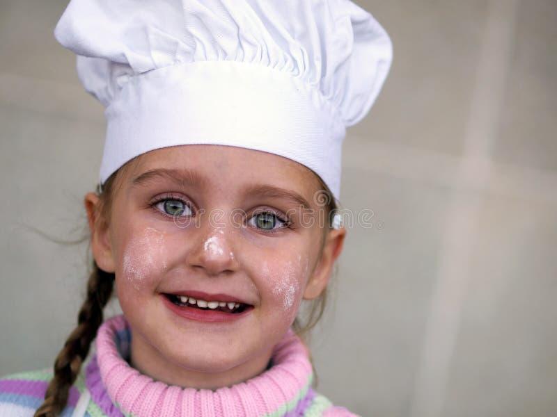 Menina do cozinheiro chefe fotos de stock royalty free