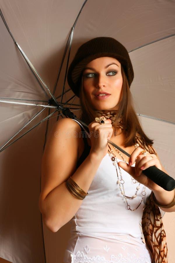 Menina do encanto com guarda-chuva fotografia de stock royalty free