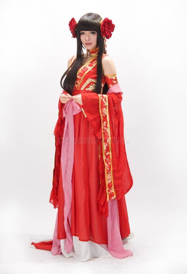 Menina do estilo chinês de Ásia no dançarino tradicional vermelho do vestido foto de stock royalty free