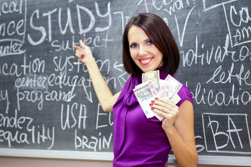 Menina do estudante com dinheiro imagens de stock