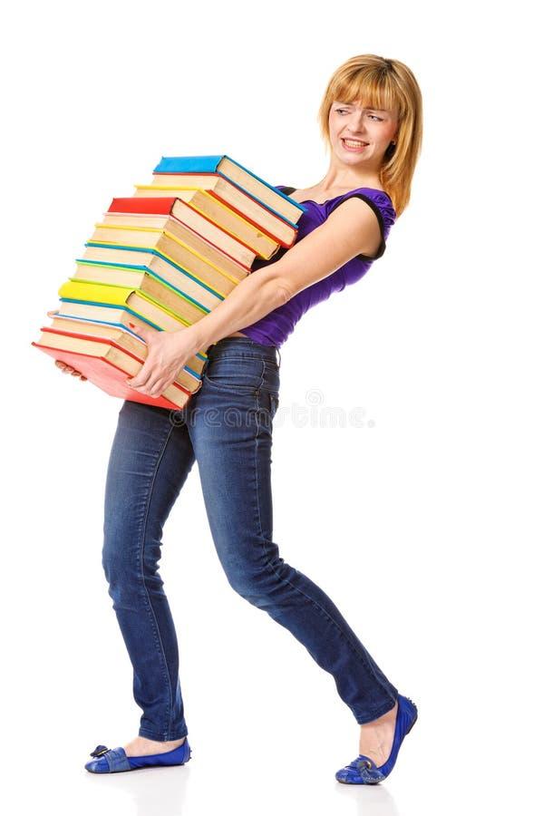 Menina do estudante com o livro da cor da pilha imagem de stock royalty free