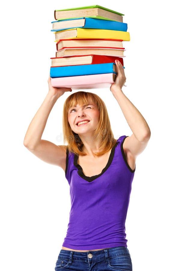 Menina do estudante com o livro da cor da pilha. Isolado fotos de stock royalty free