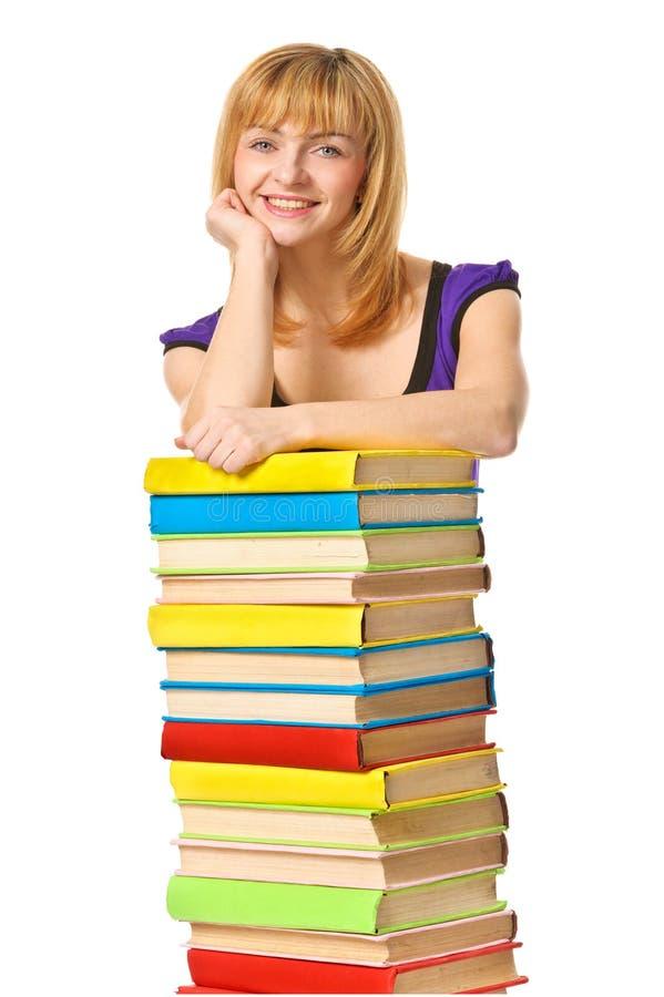 Menina do estudante com o livro da cor da pilha. Isolado imagem de stock royalty free