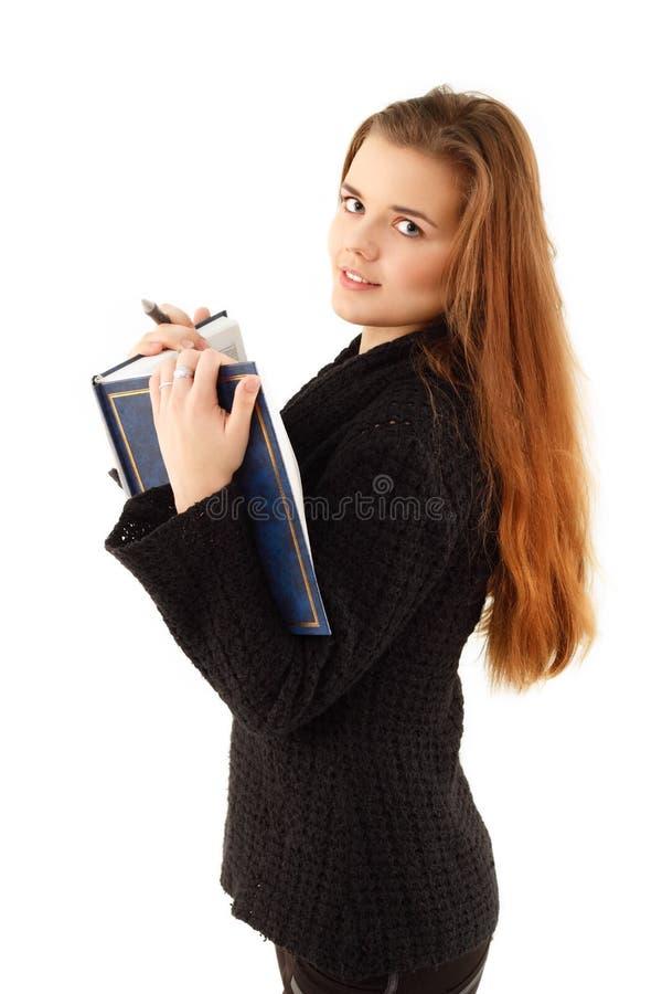 Menina do estudante da instrução com livro foto de stock
