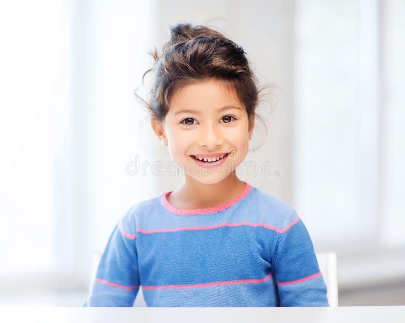 Menina do estudante na escola imagens de stock