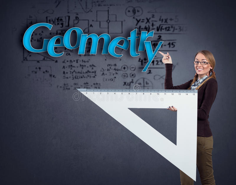 Menina do estudante que aponta na geometria da palavra imagens de stock royalty free