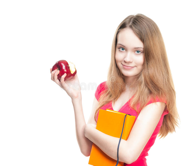 Menina do estudante que come a maçã. fotos de stock