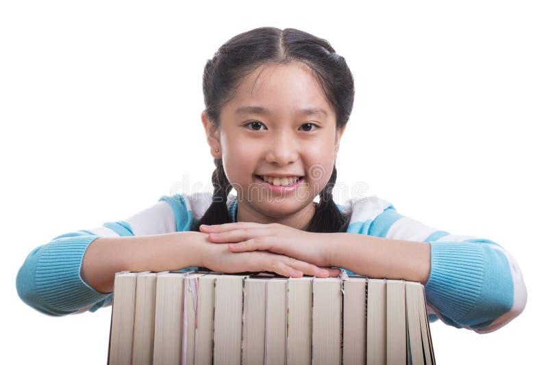 Menina do estudante que faz trabalhos de casa fotografia de stock
