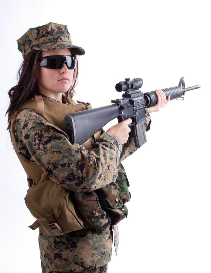 Menina do exército com tampão e injetor fotografia de stock royalty free