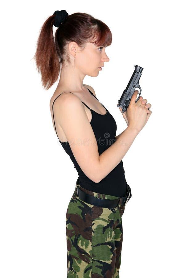 Menina do exército que aponta uma arma imagem de stock