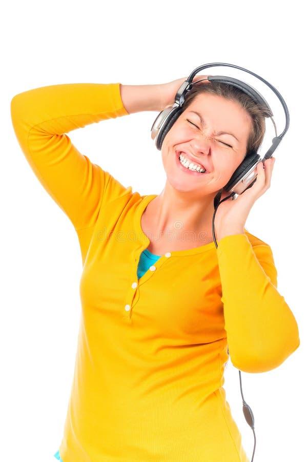 Menina do fan de música nos fones de ouvido foto de stock royalty free