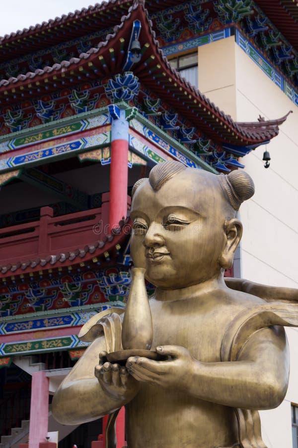 Menina do menino dourado e do jade - escultura de bronze fotografia de stock