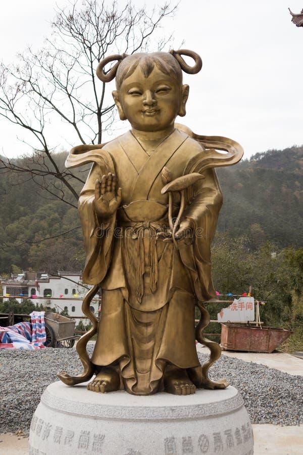 Menina do menino dourado e do jade - escultura de bronze fotos de stock