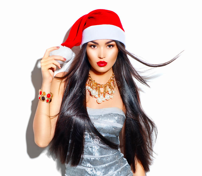 Menina do modelo de forma do Natal da beleza com cabelo longo no chapéu vermelho de Santa fotos de stock royalty free