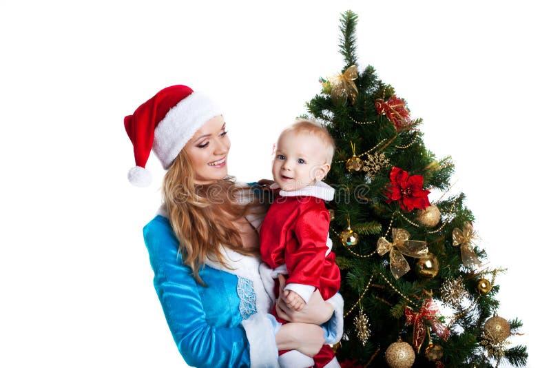 Menina do Natal com o retrato de Papai Noel do bebê imagens de stock