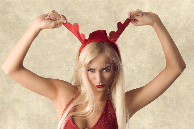 Menina do Natal com orelhas engraçadas imagem de stock royalty free
